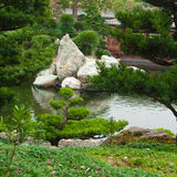 Stones in water. Stones in the small lake in the garden. Nan Lian Garden. Hong Kong Stock Image