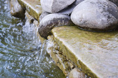 Stones in water on beauty town Ternopil Stock Photography