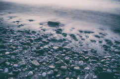 Stones and water flow Stock Photography