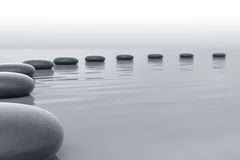 Stones in water. Forming a circle towars the horizont Stock Photos