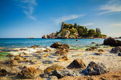 Stones in the water in front of the Isola Bella Royalty Free Stock Photos