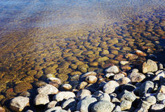 Stones in the water. Royalty Free Stock Photos