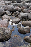 Stones in water. Royalty Free Stock Photo