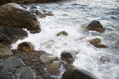 Stones with water and spray, splash. Sea coast Stock Photography