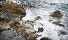 Stones with water and spray, splash. Sea coast Royalty Free Stock Photo