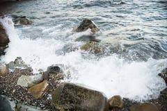 Stones with water and spray, splash. Sea coast Royalty Free Stock Photos