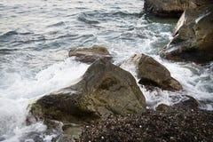 Stones with water and spray, splash. Sea coast Royalty Free Stock Image