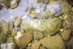 Stones and water surface. In the riverside Stock Photo