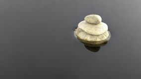 Stones in the water. Three stones on the water royalty free stock photo