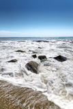 Stones in water wave black sea Stock Photo
