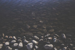 Stones on waterfront Royalty Free Stock Photos