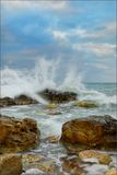 Stones in waves Royalty Free Stock Photo