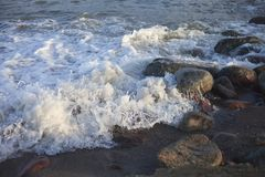 Stones in waves. Stock Photography