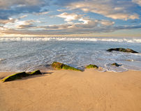 Stones in the waves on ocean coast Royalty Free Stock Images