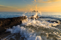 Stones and waves during sunrise in Songkha Stock Photography