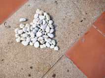 Stones were arranged in a heart shape. On ground Stock Images