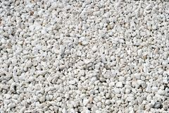 Stones-white background , sea pebbles, the texture of the stone, Royalty Free Stock Images