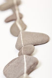 Stones with white line marking path Royalty Free Stock Photo