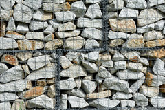 Stones in wire net Royalty Free Stock Images