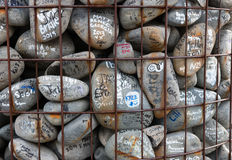 Stones with wishes and autographs in memory of victims of the e Stock Photography