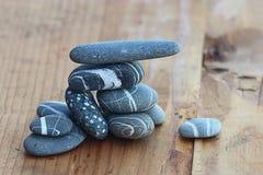 Stones on wooden background balance Stock Image