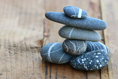Stones on wooden background balance concept Stock Images