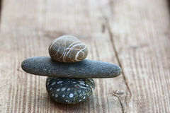 Stones on wooden background balance concept Royalty Free Stock Image
