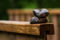 Stones on a wooden bridge. Symbol for rest Stock Photography