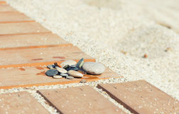 Stones on a wooden walkway Stock Images
