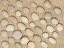 Stones on a wool fabric. Stock Images