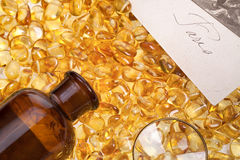 Stones of yellow amber an antique bottle of dark glass, a magnifying glass. And a sheet of paper stock photos