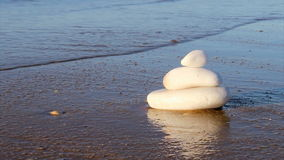 Stones in Zen style and sea waves Stock Photos