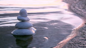 Stones in Zen style and sea waves Stock Image