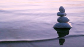 Stones in Zen style and sea waves Royalty Free Stock Photography