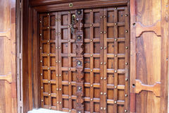 Stonetown Wooden Door Royalty Free Stock Images