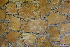 Stonewall. Yellow rock wall pieces background Stock Photography