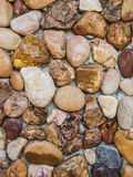 Stonewall background. Nature real stone arrange to built a wall Stock Image