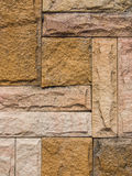 Stonewall background. Nature real stone cut out to built a wall Stock Images