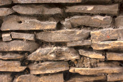 Stonewall. Closeup of brown rough antique stone wall Stock Photography