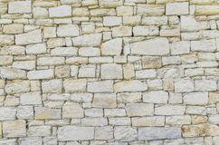 Stonewall. Detail the structure of white stone wall Stock Images