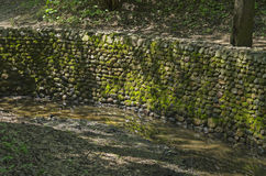 Stonewall firming creek bed. In Golosov ravine in Kolomenskoye park in Moscow. Russia Stock Images