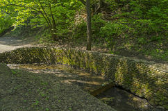 Stonewall firming creek bed. In Golosov ravine in Kolomenskoye park in Moscow. Russia Royalty Free Stock Images
