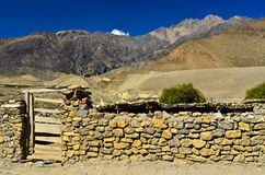 Stonewall in nepal rural. With view of mountain Royalty Free Stock Photos
