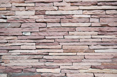 Stonewalling. The red stone walls, beautiful texture Royalty Free Stock Photos