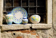 Stoneware. Dishes on a window in italy Royalty Free Stock Photos