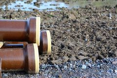 Stoneware pipes. Clay pipes stored on construction site Stock Images