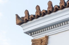 Stoneware roof decoration. In old building Royalty Free Stock Photo