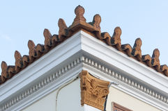 Stoneware roof decoration. In old building Royalty Free Stock Image