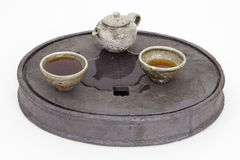 Stoneware tea set on a ceramic tea tray Royalty Free Stock Photos