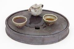 Stoneware tea set on a ceramic tea tray. Chinese black tea from Yixing served in a stoneware teapot and cups on a ceramic tea tray. The tray helps to retain Royalty Free Stock Photos